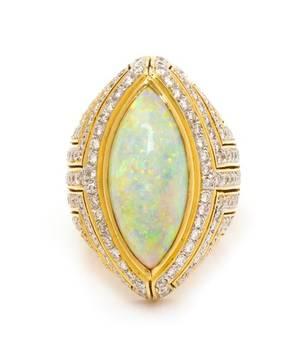 An 18 Karat Yellow Gold Opal and Diamond Ring