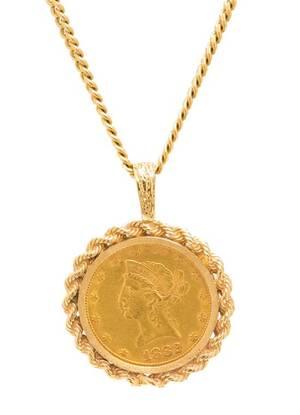A 14 Karat Yellow Gold and US 10 1882 Liberty Head Coin Pendant