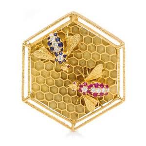 An 18 Karat Yellow Gold Ruby Sapphire and Diamond Bee Motif PendantBrooch