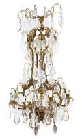 A French Gilt Bronze and Rock Crystal EightLight Chandelier