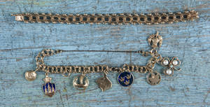 14K yellow gold charm bracelet with eight charms