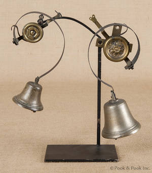 Wrought iron and brass doubledoor bell