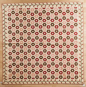 Pieced quilt with honeycomb and vine border
