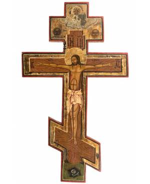 A RUSSIAN SHAPED ICON OF THE CRUCIFIXION 19TH CENTURY