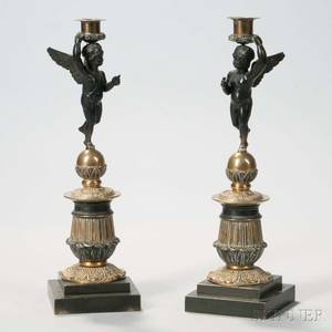 Pair of Empire Patinated and Giltbronze Figural Candlesticks