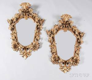 Pair of Continental Baroquestyle Giltwood Carved Mirrors