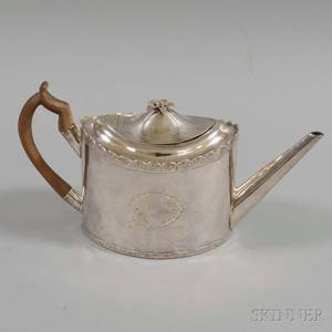 English Silverplated Teapot Four Sheffield Silverplated Coasters and a Silverplated Caster