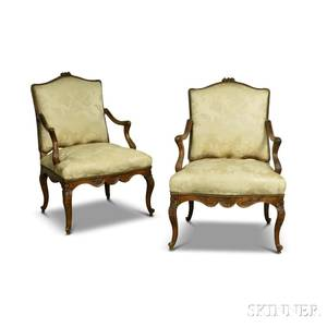 Pair of Louis XVstyle French Provincial Carved Walnut Damaskupholstered Fauteuil
