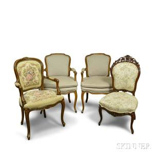 Three Louis XVstyle Carved Walnut Upholstered Fauteuil and a Side Chair