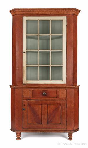 Pennsylvania painted poplar twopart corner cupboard ca 1820