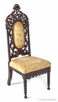 Victorian carved mahogany cathedral chair