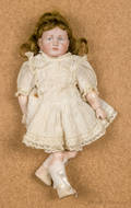 Kammer  Reinhardt bisque head doll with a pouty mouth