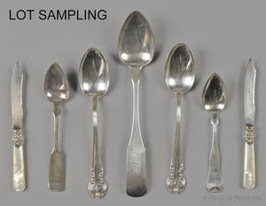 Group of coin and sterling silver spoons