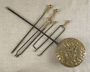 Group of brass fireplace accessories