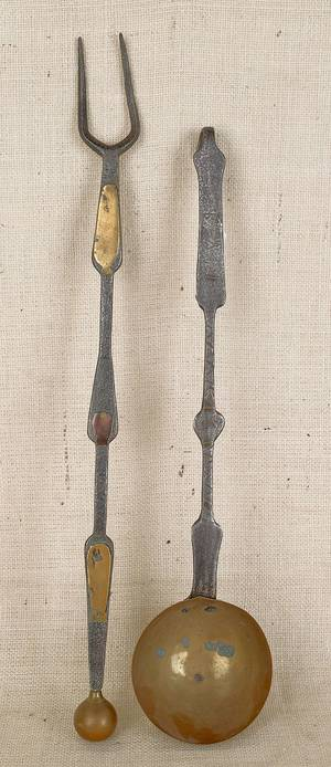 Pair of Pennsylvania brass inlaid wrought iron utensils the dipper dated