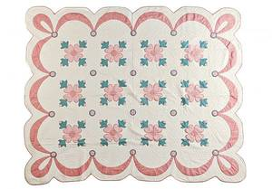 Floral appliqu quilt with a swag border