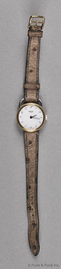 Herms Arceau ladys wristwatch with Arabic numerals and an ostrich band