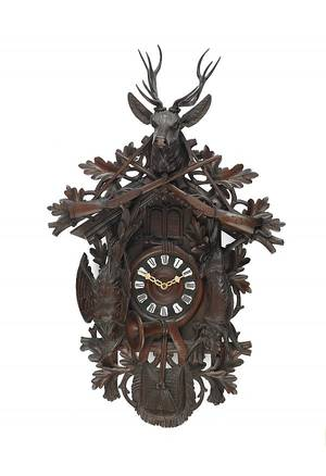 Large Black Forest carved walnut cuckoo clock late 19th c