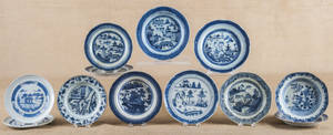 Twelve Chinese export porcelain blue and white plates and shallow bowls