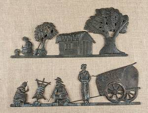 Pair of embossed sheet iron plaques late 19th c