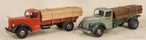 Two Smith Miller pressed steel log trucks