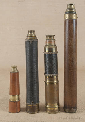 Four brass telescopes