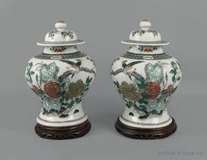 Pair of Chinese famille verte porcelain covered urns 19th c
