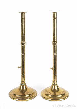 Pair of large English brass push up candlesticks 19th c