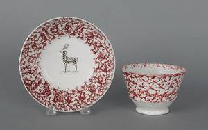 Red sponge cup and saucer with a deer 19th c