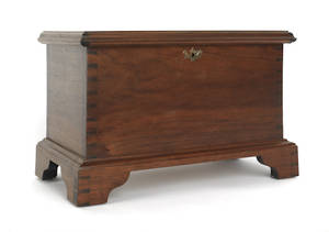 Contemporary Chippendale style walnut blanket chest