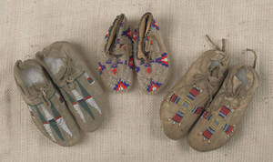 Two pair of partially beaded Sioux childs moccasins