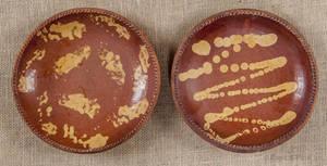 Two Pennsylvania redware pie plates 19th c