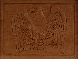 Two carved mahogany eagle plaques