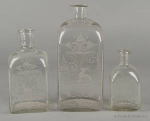 Three blown colorless glass apothecary jars 19th c