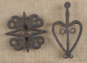 Two wrought iron trivets in heart form early 19th c