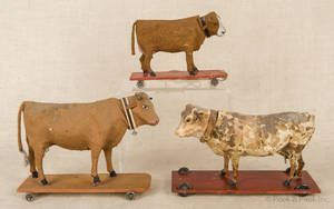 Three composition cow pull toys