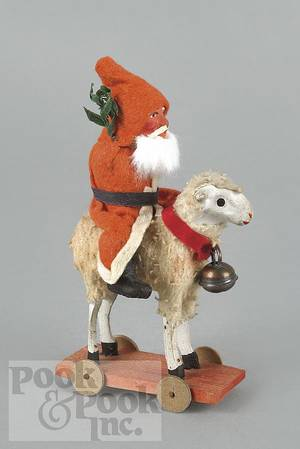 German composition Santa Claus riding a sheep pull toy