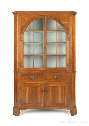 Pennsylvania Federal cherry twopart corner cupboard ca 1810