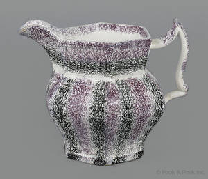 Black and purple rainbow spatter creamer 19th c