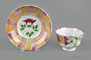 Red and yellow rainbow spatter cup and saucer 19th c