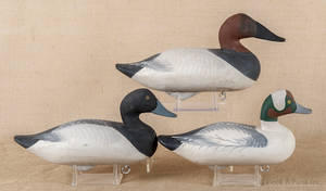 Two carved and painted duck decoys both signed and dated
