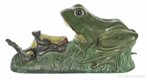 Cast iron Two Frogs mechanical bank manufactured by J  E Stevens Company