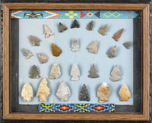 Twentyfive Native American arrowheads