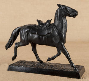 Patinated metal sculpture of a horse