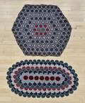 Two felt penny rugs