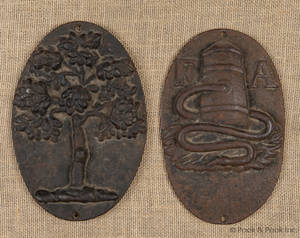 Two cast iron fire marks