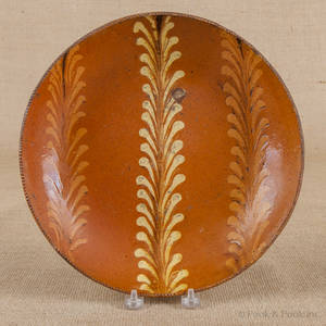 Pennsylvania slip decorated redware plate 19th c
