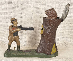 Cast iron  Teddy and the Bear  mechanical bank manufactured by J  E Stevens  Company