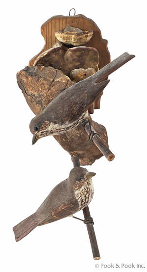 Pair of carved and painted birds on a fungus perch