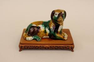 Green and Brown Recumbent Dog on Stand